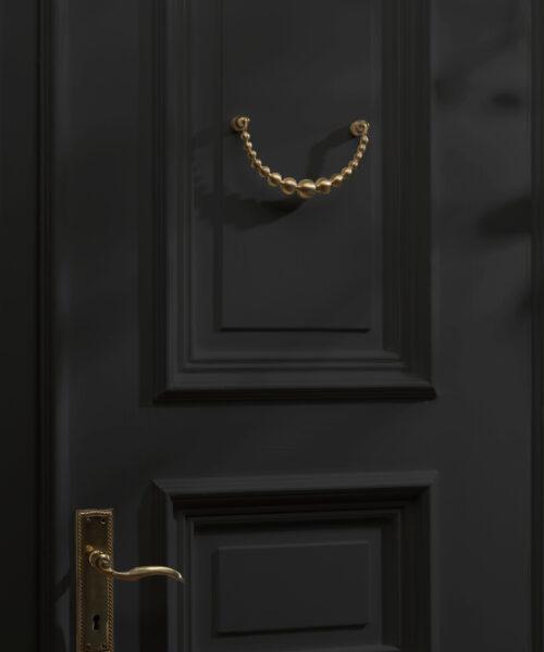 door knocker gold brass